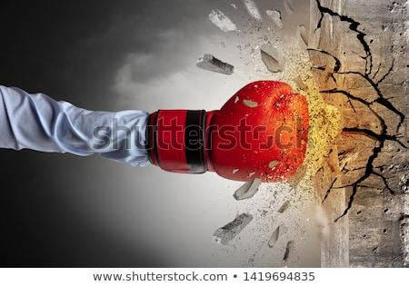 Hand hits intense and breaks stonewall Photo stock © ra2studio