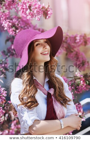 Stock photo: beautiful young woman near the blossoming spring tree