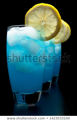 Close up view of blue lagoon cocktails with ice cubes on black Stock photo © dla4