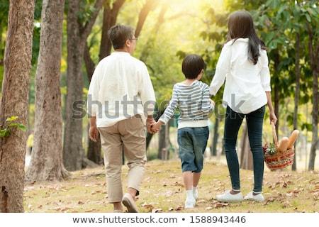 happy family going to picnic on beach in autumn stock photo © dolgachov
