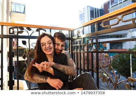 Young tattooed stylish couple hugging in bedroom Stock photo © dashapetrenko
