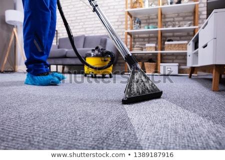 Gondnok takarítás szőnyeg porszívó kilátás férfi Stock fotó © AndreyPopov