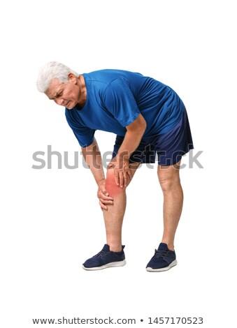uomo · ginocchio · dolore · sofferenza · seduta · divano - foto d'archivio © andreypopov