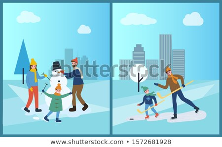 Man Sculpting Snowman, Adult Playing Winter Games Stock photo © robuart