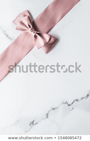 Beżowy jedwabiu wstążka łuk marmuru glamour Zdjęcia stock © Anneleven