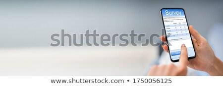 人 充填 調査 フォーム 携帯電話 クローズアップ ストックフォト © AndreyPopov