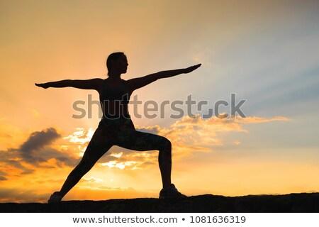 Genç kadın yoga pilates gün batımı gündoğumu Stok fotoğraf © galitskaya