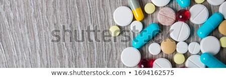 Bannière coloré médication pilules au-dessus gris Photo stock © Illia
