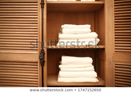 Stacks of clean white soft towels in cupboard in room Stock photo © dashapetrenko