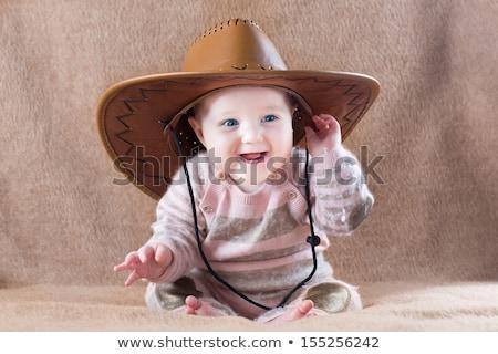 Cappello da cowboy mani indossare rosso Foto d'archivio © JamiRae
