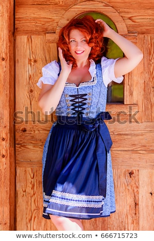 portrait of a smiling redhead woman in bavarian dress stock photo © Rob_Stark