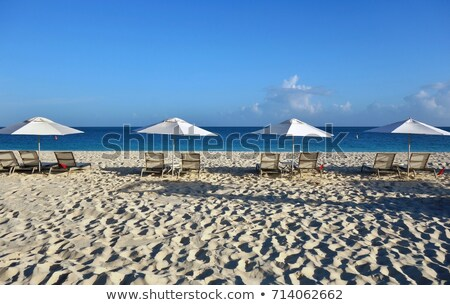 Lounge chairs and beach umbrellas on Grace Bay Beach Stock photo © jsnover