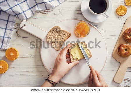 Woman eating a slice of buttered bread Stock photo © photography33