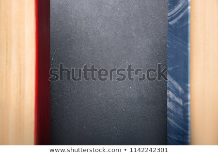 Football and blank notebook on grunge vintage background Stock photo © Archipoch