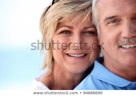 Házaspár tengerpart égbolt mosoly pár nyár Stock fotó © photography33
