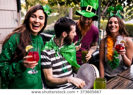 smiling st patricks day leprechaun holding shamrock clover stock photo © chromaco