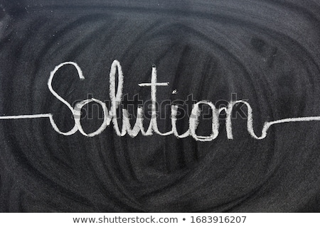 solutions written on a blackboard stock photo © latent