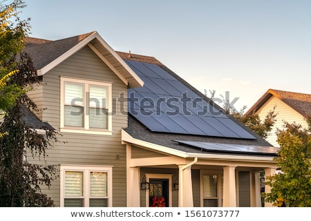 Nap ház ökológiai napelemek különböző színek Stock fotó © xedos45
