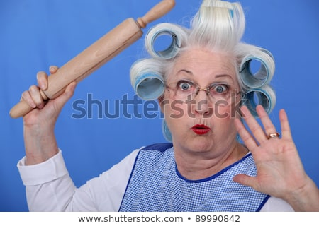 Scared old lady with hair rollers Stock photo © photography33