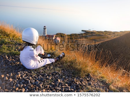 Astronaut girl with silver uniform and glass helmet Stock photo © lunamarina