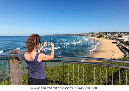 Vörös hajú nő tengerpart Newcastle Ausztrália szép napos Stock fotó © jeayesy