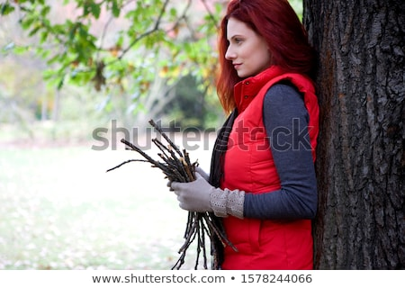 Woman leaning against tree Stock photo © photography33