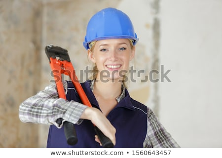 Woman carrying bolt-cutters over shoulder Stock photo © photography33