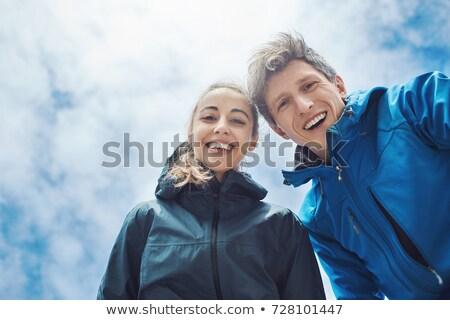 Jeune fille regarder caméra inférieur blanche sourire Photo stock © Rebirth3d