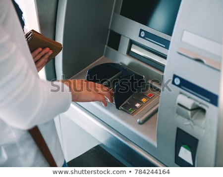 Woman using Bank ATM machine Stock photo © adamr
