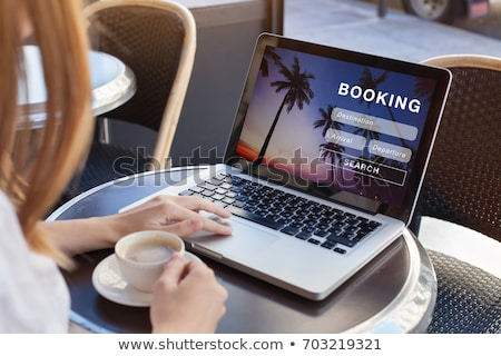 On-line viajar reserva tiro passaporte laptop Foto stock © aremafoto