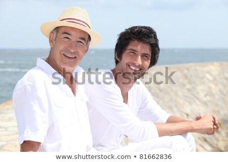 Rok stary 30 lat posiedzenia piasku morza Zdjęcia stock © photography33