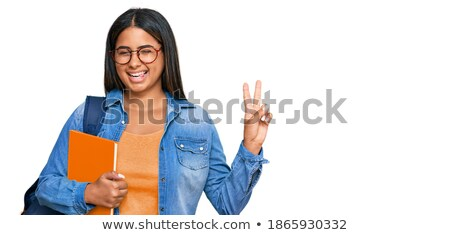 Brunette holding two finger to face Stock photo © photography33
