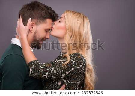 Woman kissing man on the forehead Stock photo © photography33