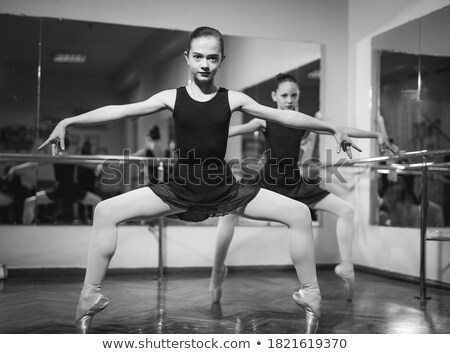 Pretty girl in graceful pose standing in studio Stock photo © gromovataya