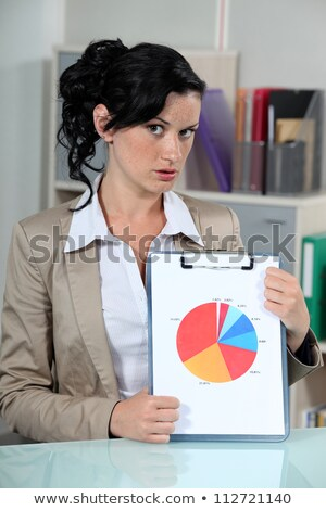 Woman displaying the results of a survey in pie chart format Stock photo © photography33