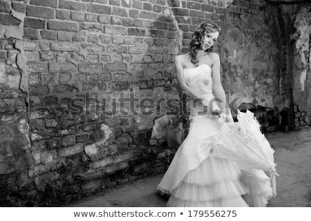 Bride blonde in white wedding dress and gloves stock photo © gromovataya