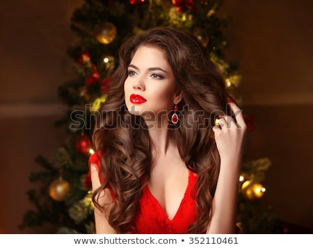 Beautiful woman with curly hair and evening make-up. Jewelry and Stock photo © Victoria_Andreas