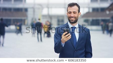 笑みを浮かべて ビジネスマン 送信 メッセージ 携帯電話 白 ストックフォト © wavebreak_media