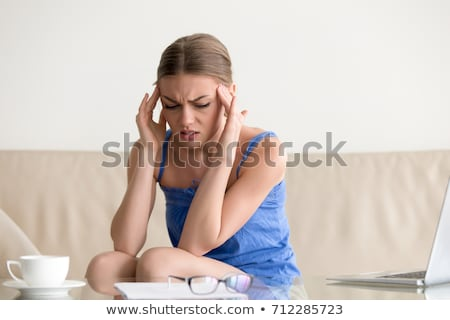 concentrated woman having a head massage stock photo © wavebreak_media