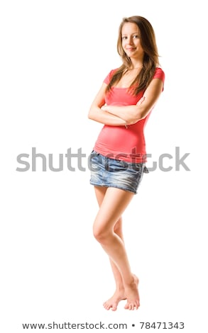 Cute girl in jeans mini skirt. Isolated  stock photo © acidgrey