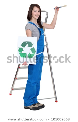lovely brunet painter in blue dungarees holding brush and recycling logo Stock photo © photography33