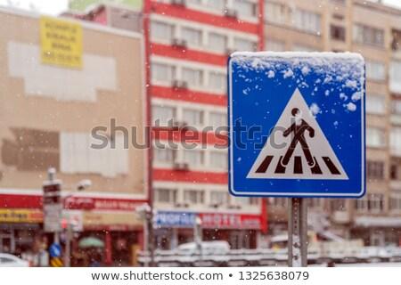 Tél gyalogos gyalogosok tükröződés nedves beton Stock fotó © eldadcarin