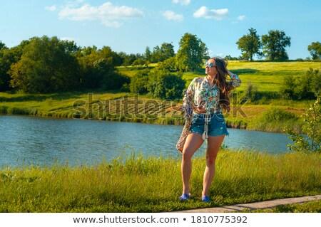 Largo mujer bonita piernas primavera pradera flor Foto stock © Kesu