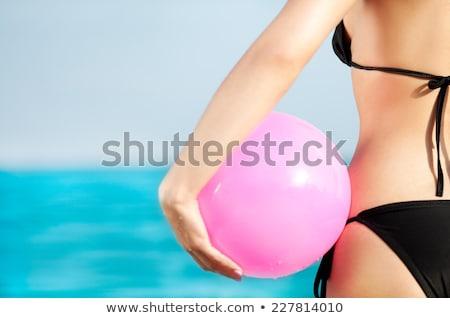 Bikini vrouw kleurrijk strandbal sensueel Stockfoto © stockyimages