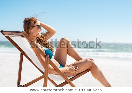 red haired woman wearing bikini stock photo © chesterf