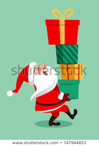 santa claus carrying big stack of christmas gifts stock photo © hasloo