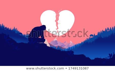 sad lover sitting on red heart stock photo © kirill_m