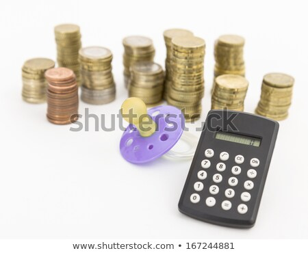 pacifier with hard money and pocket calculator Stock photo © gewoldi