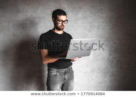 glimlachend · jonge · man · witte · tshirt · ontwerp · gebaar - stockfoto © dolgachov