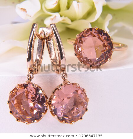 pink background with the Golden flower of precious stones Stock photo © yurkina